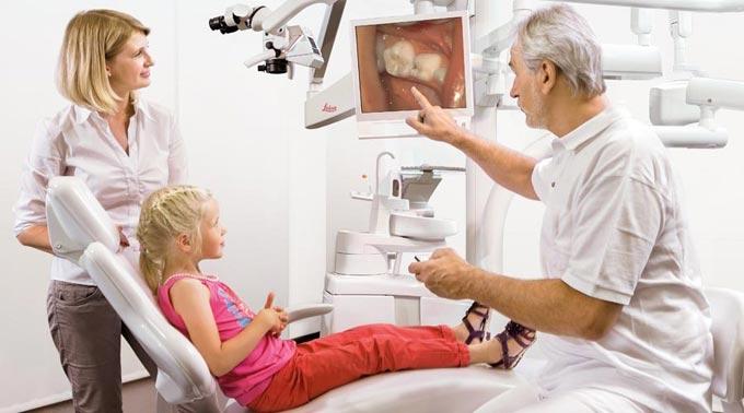 лечение каналов зуба под микроскопом