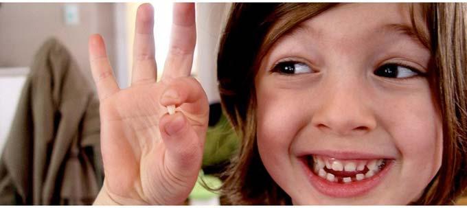 вырвать молочный зуб